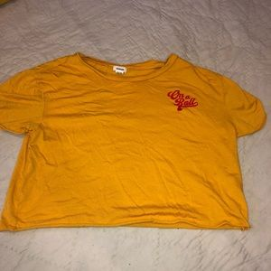 orange short sleeve shirt with red logo garage